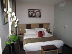 Source hotel chambre lit double St Ouen